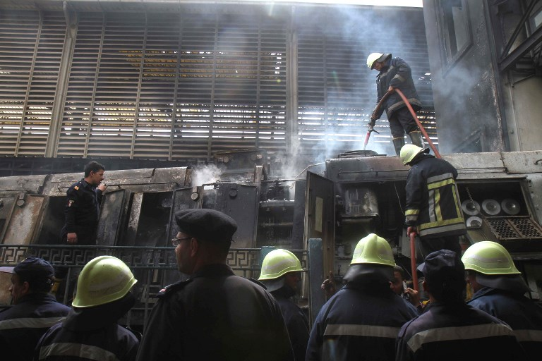At the scene of a fiery train crash at the Egyptian capital Cairo