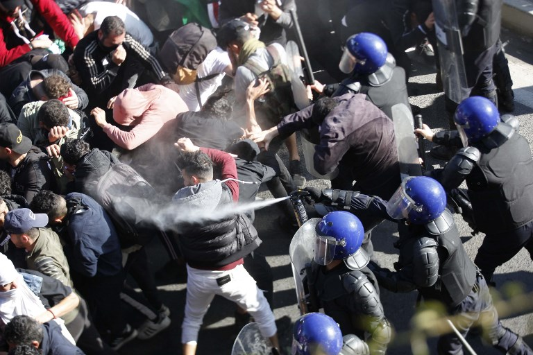 Police and demonstrators clash in Algeria