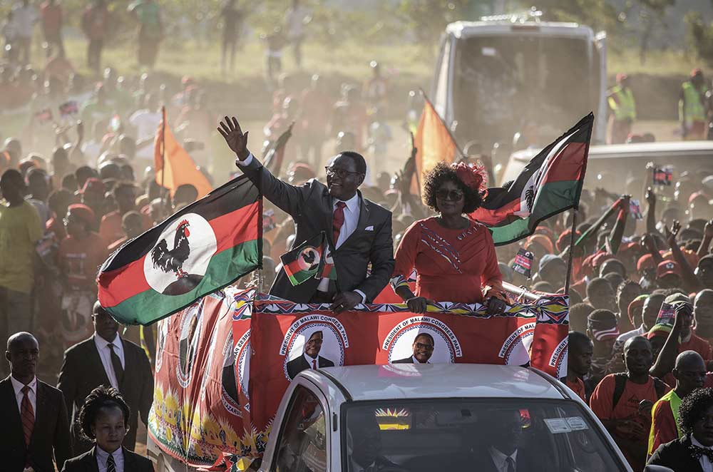 Opposition Malawi Congress Party (MCP) leader and presidential candidate Lazarus Chakwera waves to the crowd