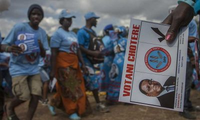 A supporter of Malawi's ruling Democratic Party holds a dummy ballot paper