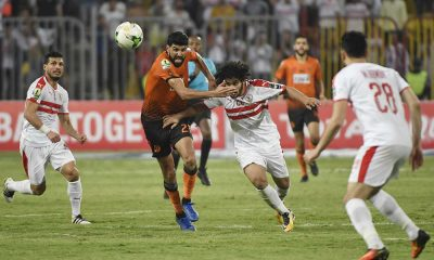 Egypt's Zamalek player Abdallah Saleh (C) vies for the ball with Morocco's RSB Berkane player Baker el-Helali (R)