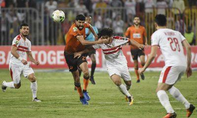 Egypt's Zamalek player Abdallah Saleh (C) vies for the ball with Morocco's RSB Berkane player Baker el-Helali (R)