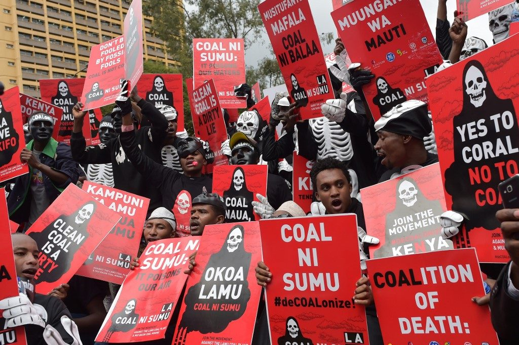 Activists march in Nairobi, to denounce plans by the Kenyan government to mine coal close to the pristine coastal archipelago of Lamu