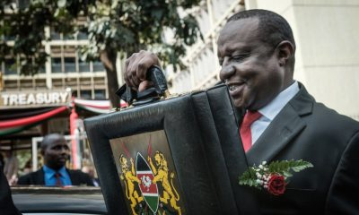 Kenya's Cabinet Secretary for National Treasury Henry Rotich leaves with the budget briefcase for Parliament to read