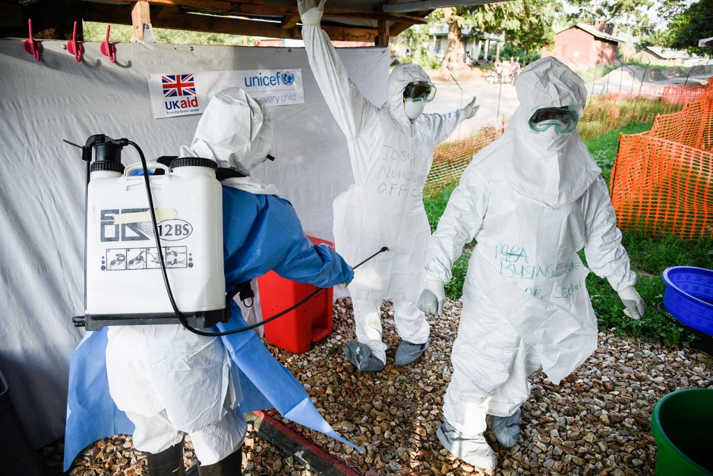 Medical staff of the Ebola Treatment Unit (ETU) get ready to work in their Personal Protective Equipment (PPE) during their weekly rehearsal at the Bwera General Hospital
