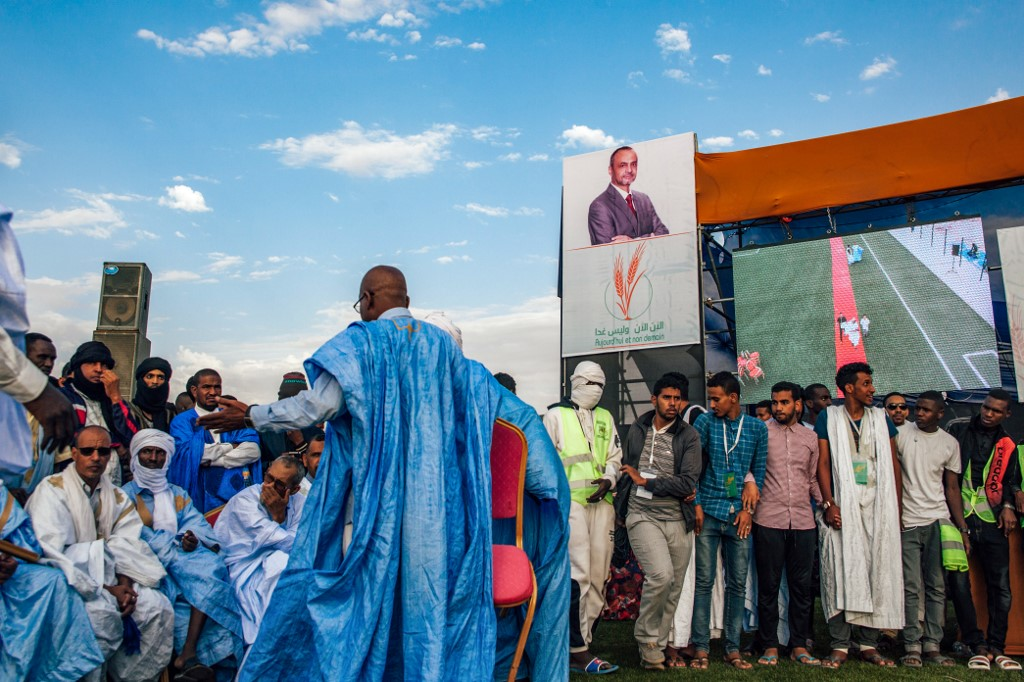Mauritania Elections: Supporter sit during a campaign rally of Sidi Mohamed Ould Boubacar