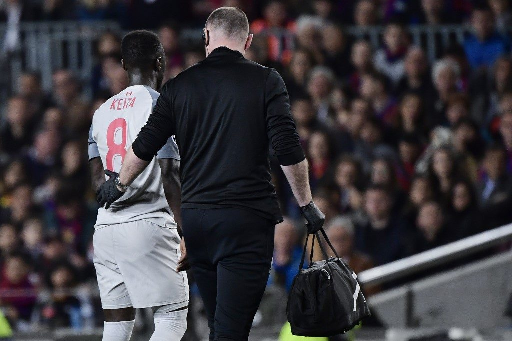 Liverpool's Guinean midfielder Naby Keita, who makes the AFCON 2018 squad for Guinea walks off the pitch after being injured