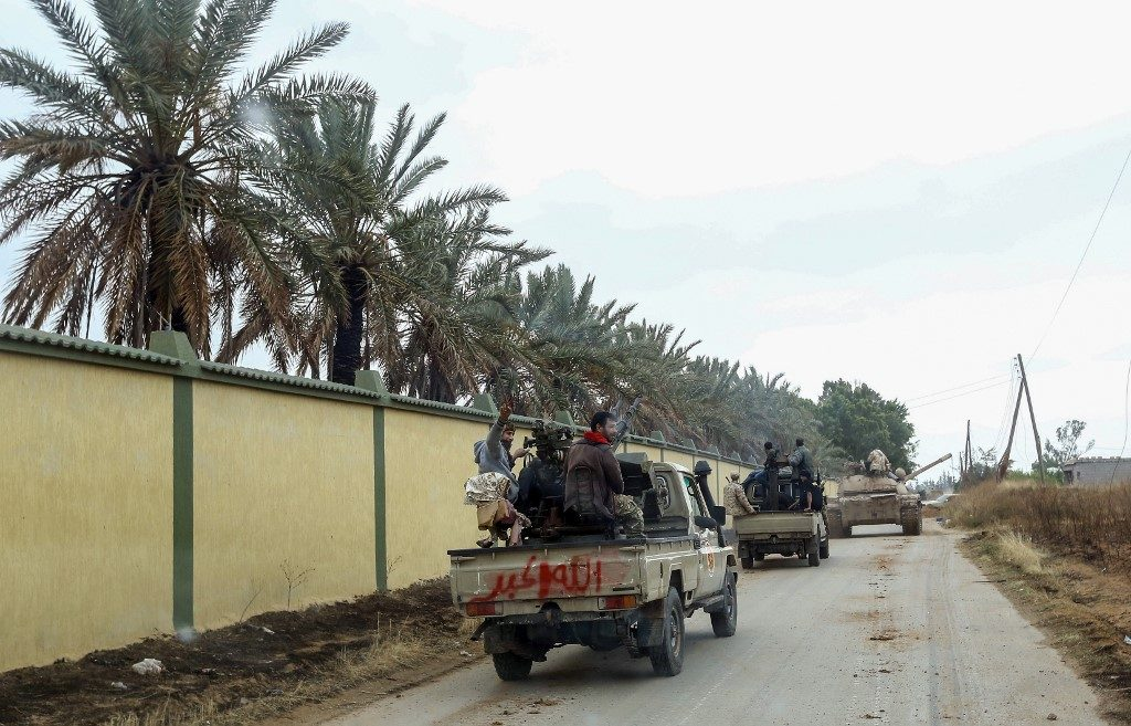 Vehicles belonging to Libyan fighters loyal to the Government of National Accord (GNA) are pictured during clashes against forces loyal to strongman Khalifa Haftar
