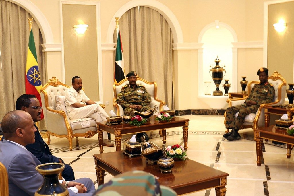 Ethiopia's Prime Minister Abiy Ahmed (C-L) meets with the chief of Sudan's ruling military council, General Abdel Fattah al-Burhan (C-R), in Khartoum on June 7, 2019.