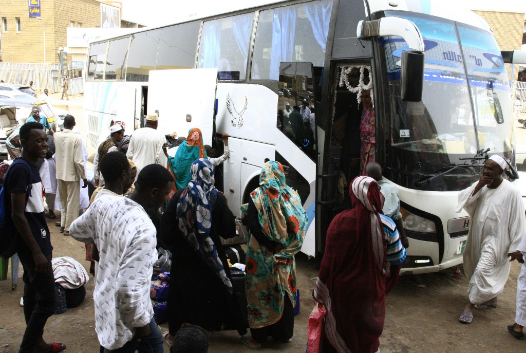 Passengers wait for their shuttle at the main bus station in Khartoum, linking the Sudanese capital with various parts of the country,