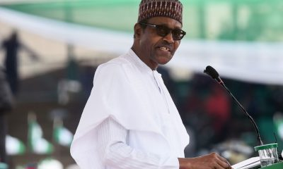 Nigerian President Muhammadu Buhari delivers a speech during celebrations to mark Democracy Day in Abuja, on June 12, 2019