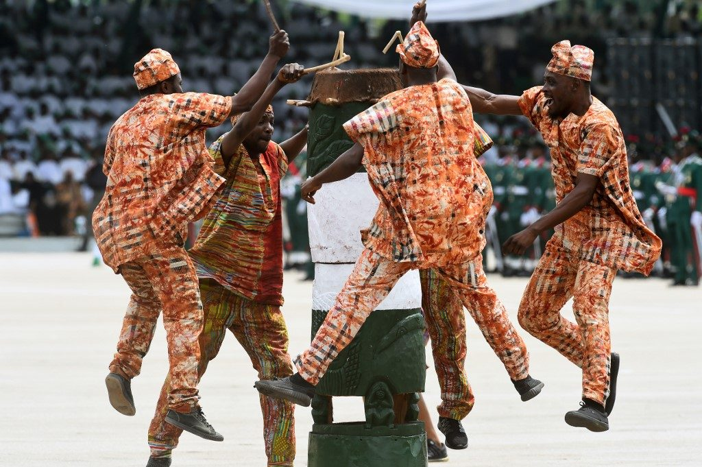 Buhari second term: Members of the National cultural troupe of Nigeria perform during the Democracy Day celebrations in Abuja,