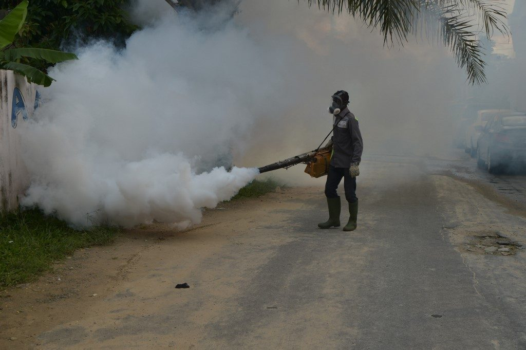 National institute for public hygiene (INHP) are at work to fumigate an area as part of efforts to fight the spread of Dengue in Ivory Coast