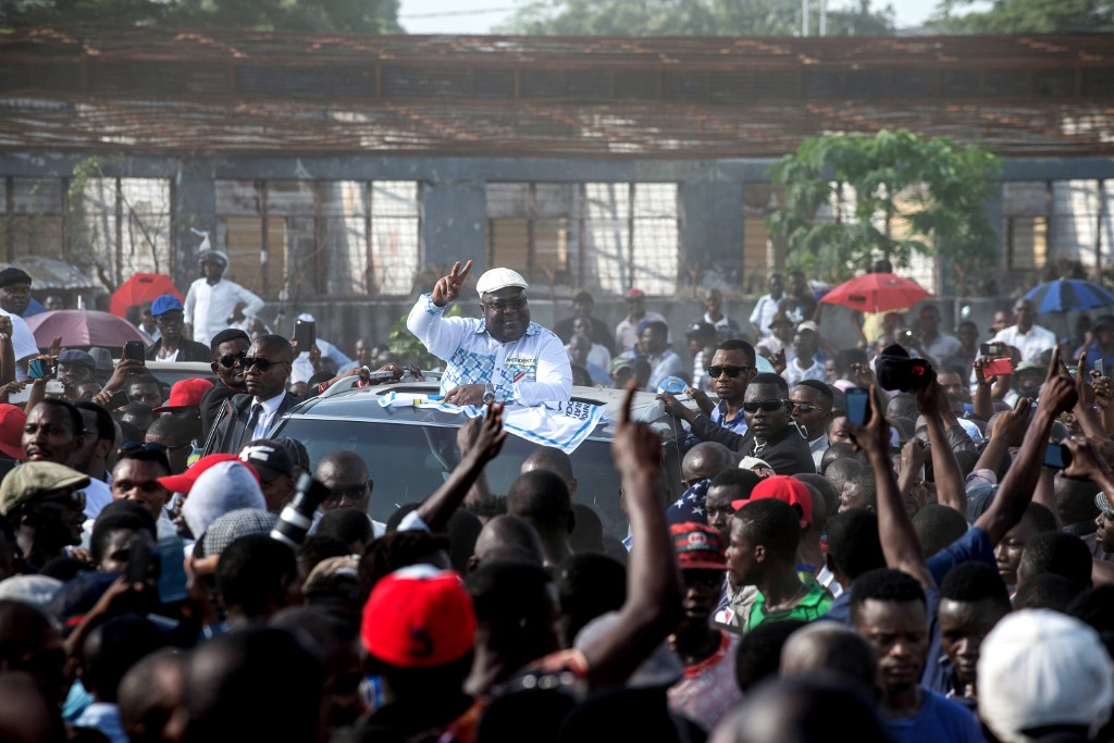 UDPS opposition party leader Felix Tshisekedi gestures to supporters as Authorities bans rallies