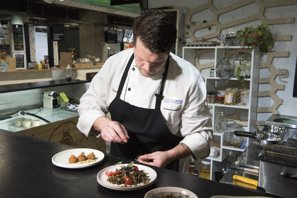 Mario Barnard, chef at Gourmet Grubb, works at his food stand
