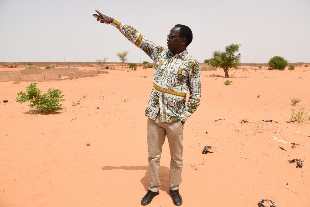 Mamane shows the site where he will construct his future school of comedy, in Niamey,