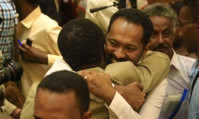 Protest leaders celebrate after the signing of the constitutional declaration with Sudan's army rulers