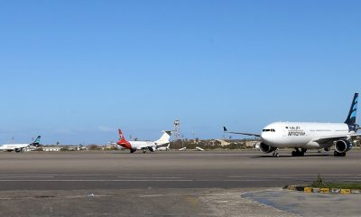 Grounded air-planes sit on the tarmac at Mitiga International Airport as Flights have resumed
