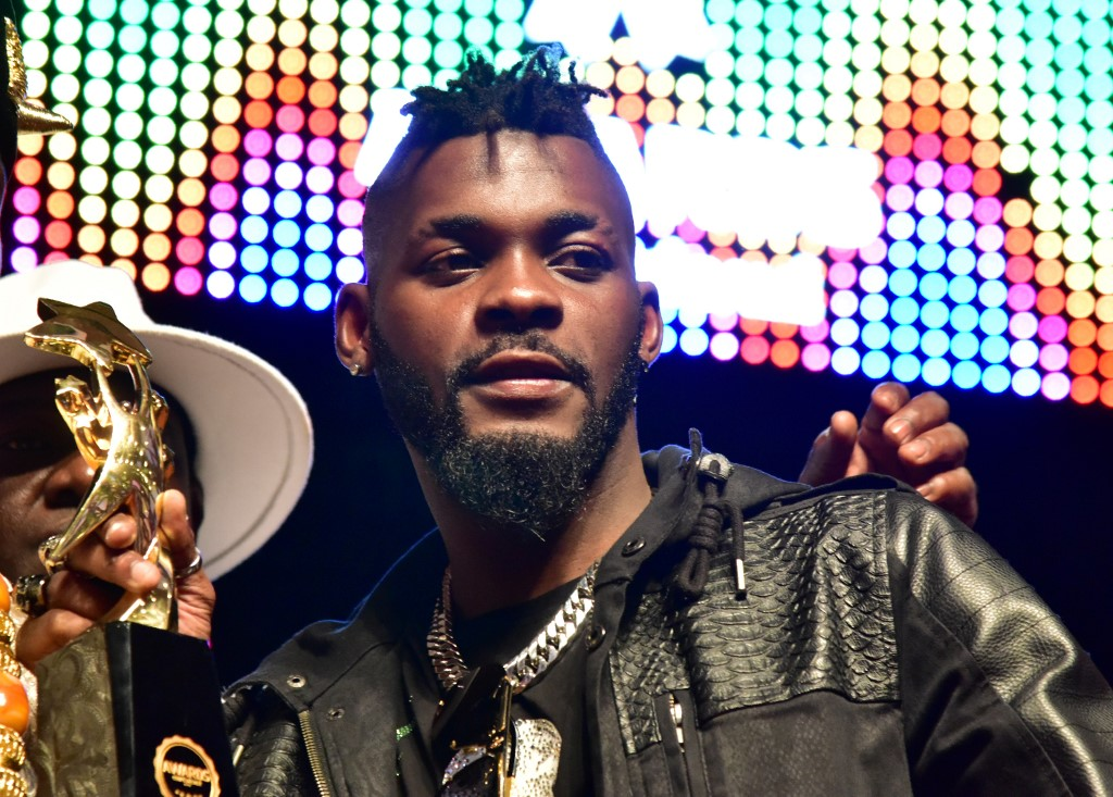 Ivory Coast's musician DJ Arafat holds the award for best artist of the year during the Coupe-Decale Awards in Abidjan