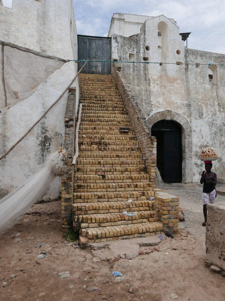 """Stairs next to the """"Door of Return"""", the former """"Door of no Return"""" of  the Cape Coast Castle"""