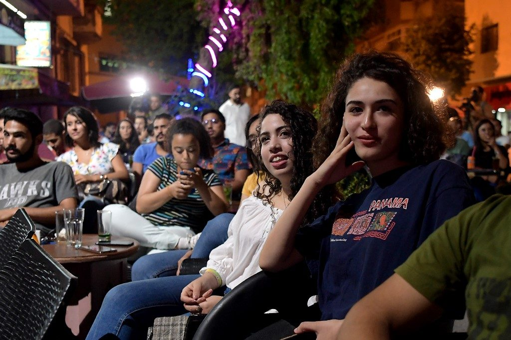 Tunisian poeple watch the Presidential TV debate in a cafe on September 7, 2019