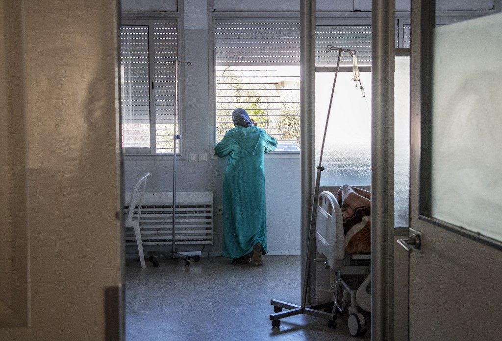 A relative of a Moroccan AIDS patient looks out the window in the infectious diseases department at the Ibn Rochd Hospital in Casablanca