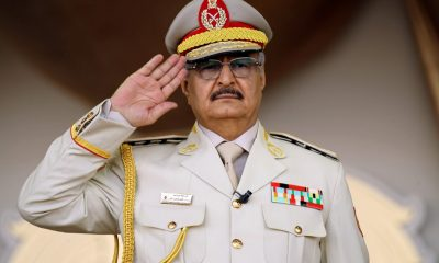 "Khalifa Haftar salutes during a military parade in the eastern city of Benghazi, during which he announced a military offensive to take from ""terrorists"" the city of Derna"