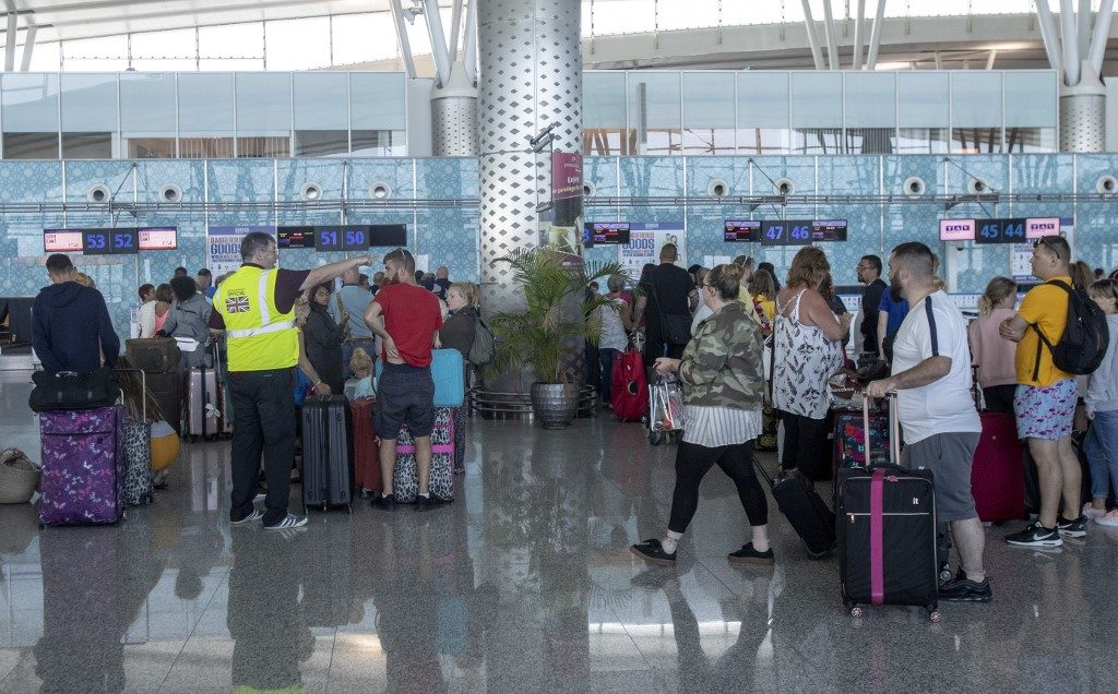 British tourists, flying with Thomas Cook, queue at the Enfidha Hammamet International Airport, in Sousse,
