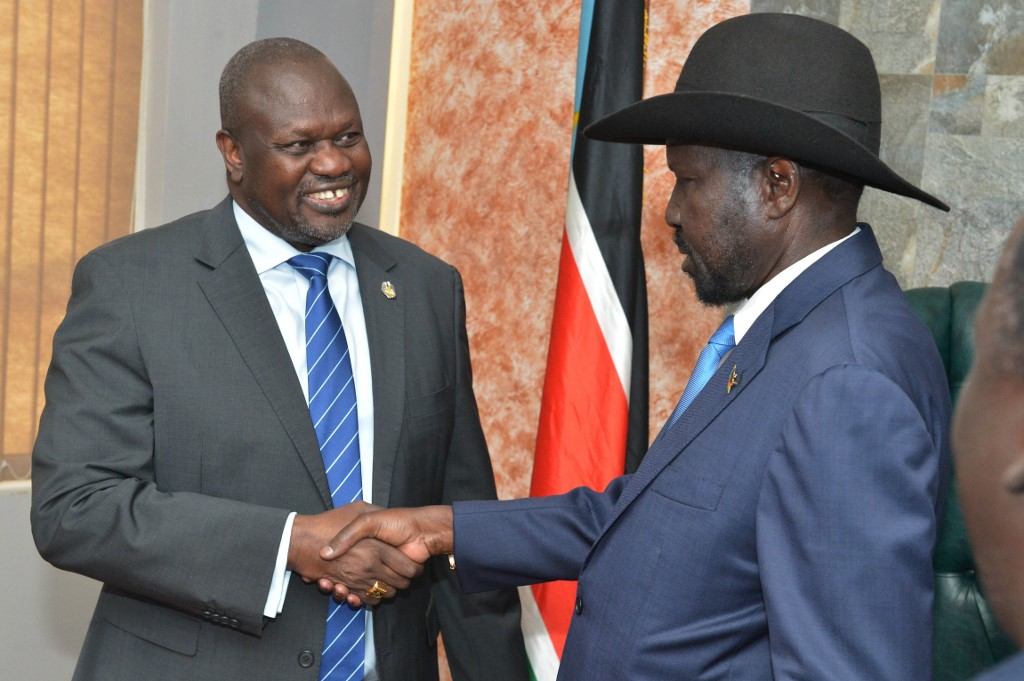 President Salva Kiir and rebel leader Riek Machar pledge to power-sharing deal