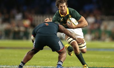 Eben Etzebeth of South Africa (R) is tackled by Jefferson Poirot of France