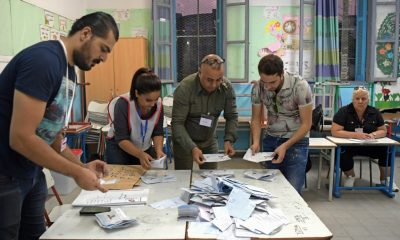 Tunisian electoral officials count the ballots at a polling station in the capital Tunis,