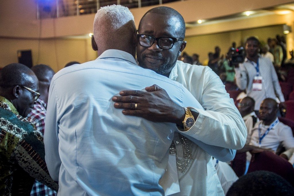 Newly elected President of Ghana Football Association (GFA) Kurt Okraku (R) is congratulated by a man after the GFA president's election at the Physicians and Surgeons Centre in Accra on October 25, 2019.