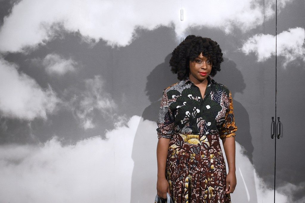 Nigerian writer Chimamanda Adichie poses prior to the start of the Christian Dior Women's Fall-Winter