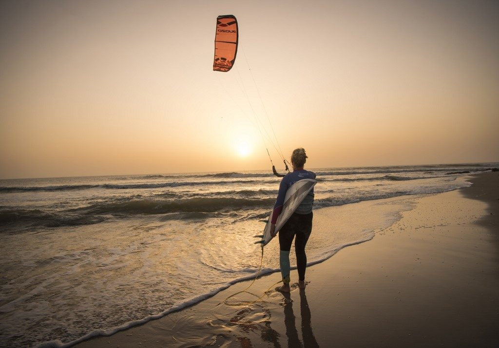 A kitesurfer manoeuvring her kite at Dakhla beach in Morocco-administered Western Sahara.