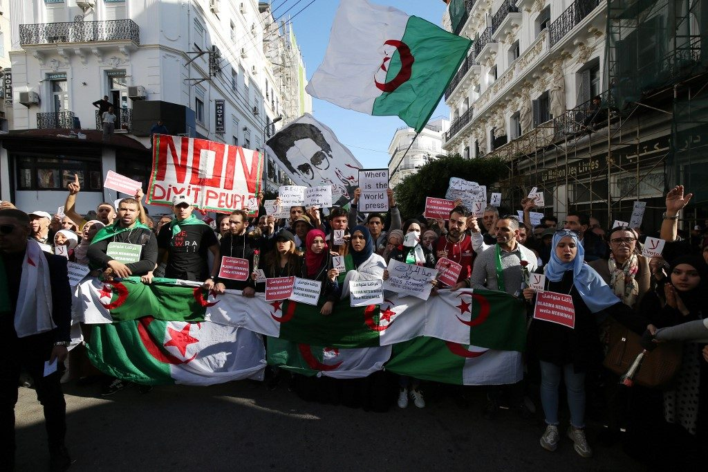 Protesters march against December general elections in Algeria